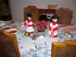 two christmas puppets are on a table